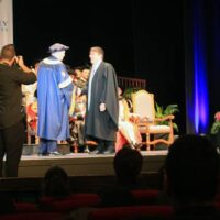 Paul receiving diploma
