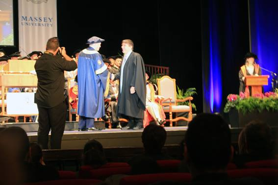 Paul receiving diploma